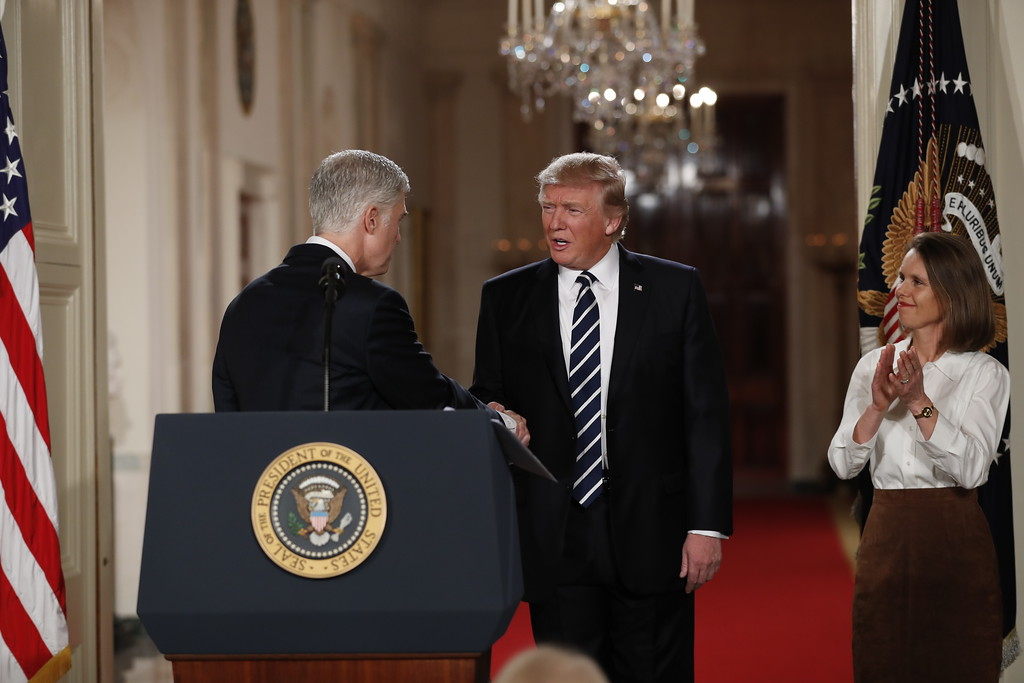 . President Donald Trump shakes hands with Judge Neil Gorsuch in the East Room of the White House in Washington, Tuesday, Jan. 31, 2017, after Trump announced Gorsuch as his nominee for the Supreme Court. Watching Gorsuch\'s wife Louise. (AP Photo/Carolyn Kaster)