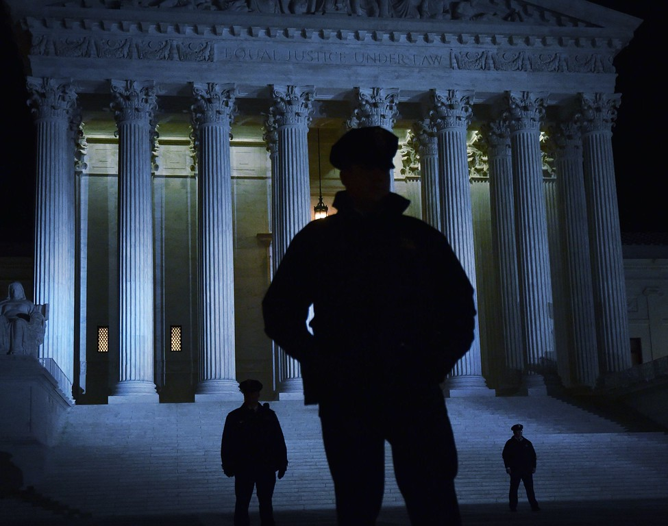 . Police stand outside the US Supreme Court on January 31, 2017 in Washington, DC. President Donald Trump nominated federal appellate judge Neil Gorsuch as his Supreme Court nominee, tilting the balance of the court back in the conservatives\' favor. (PAUL J. RICHARDS/AFP/Getty Images)