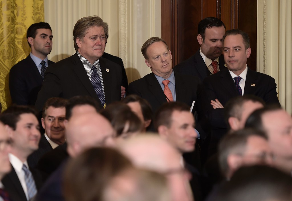. Trump advisor Steve Bannon (2L),  White House Chief of Staff Reince Priebus (R), and White House spokesman Sean Spicer look on before the announcement of the Supreme Court nominee at the White House in Washington, DC, on January 31, 2017. President Donald Trump nominated federal appellate judge Neil Gorsuch as his Supreme Court nominee, tilting the balance of the court back in the conservatives\' favor. (BRENDAN SMIALOWSKI/AFP/Getty Images)