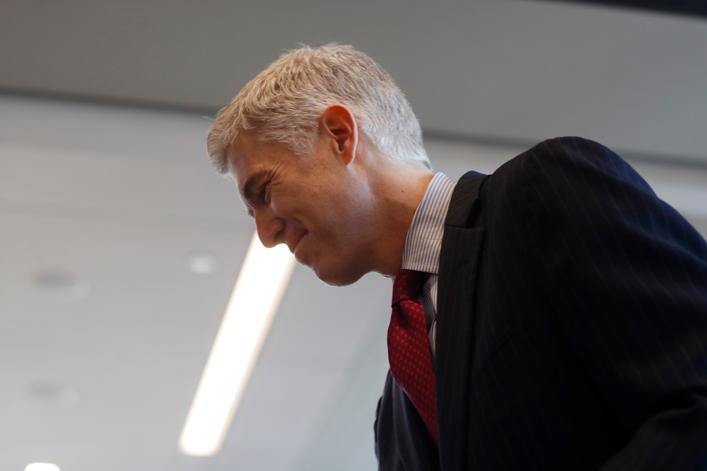 . In this Friday, Jan. 27, 2017, photograph, 10th U.S. Circuit Court of Appeals Judge Neil Gorsuch makes a point while delivering prepared remarks before a group of attorneys at a luncheon in a legal firm in lower downtown Denver. (AP Photo/David Zalubowski)