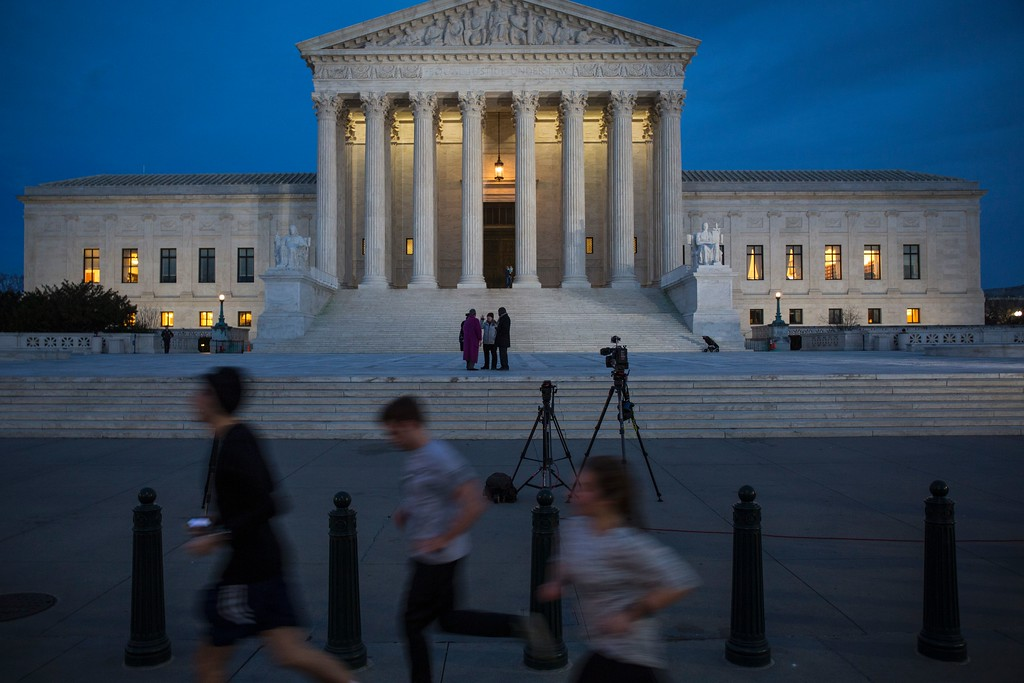 . People jog past the United States Supreme Court in Washington, DC, on January 31, 2017, before President Donald Trump announces his nominee to fill the seat of former Associate Justice of the Supreme Court Antonin Scalia.   President Donald Trump was poised to unveil his pick for the US Supreme Court, a crucial appointment that could tilt the bench to conservatives on deeply divisive issues such as abortion and gun control. (ZACH GIBSON/AFP/Getty Images)