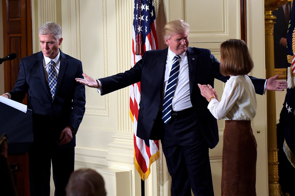 . President Donald Trump gestures toward Louise Gorsuch after announcing 10th U.S. Circuit Court of Appeals Judge Neil Gorsuch as his choice for Supreme Court Justice during a televised address from the East Room of the White House in Washington, Tuesday, Jan. 31, 2017. (AP Photo/Susan Walsh)