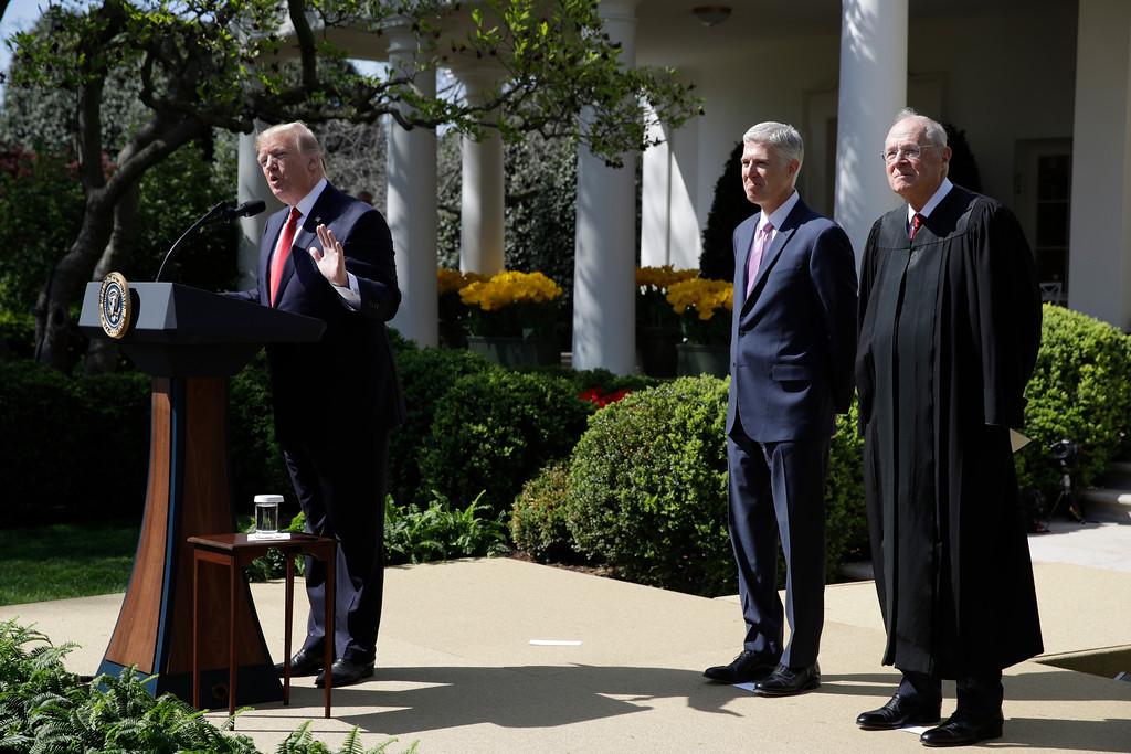 . President Donald Trump, accompanied by Supreme Court Justice Anthony Kennedy, right, and Justice Neil Gorsuch speaks in the Rose Garden of the White House White House in Washington, Monday, April 10, 2017, before a public swearing-in ceremony for Gorsuch. (AP Photo/Evan Vucci)