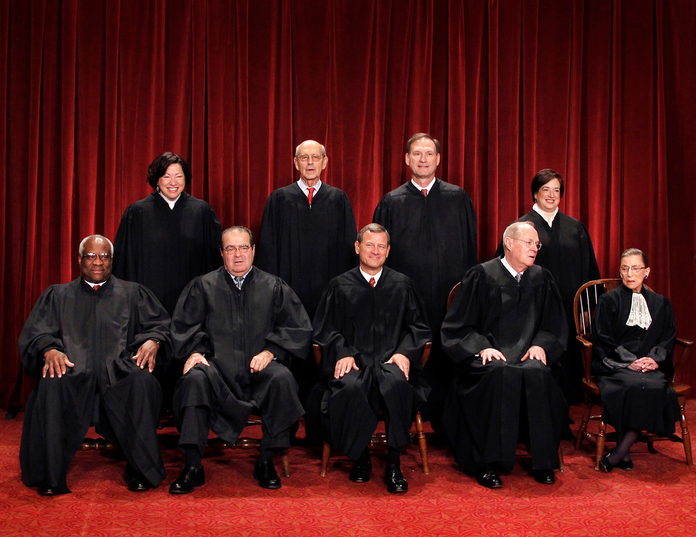 . FILE - In this Oct. 8, 2010 file photo, the Supreme Court justices pose for a group photo at the Supreme Court in Washington. Seated, from left are, Justice Clarence Thomas, Antonin Scalia, Chief Justice John Roberts, Justice Anthony Kennedy, and Justice Ruth Bader Ginsburg. Standing, from left are, Justices Sonia Sotomayor, Stephen Breyer, Samuel Alito Jr., and Elena Kagan. On Saturday, Feb. 13, 2016, the U.S. Marshals Service confirmed that Scalia had died at the age of 79. (AP Photo/Pablo Martinez Monsivais, File)