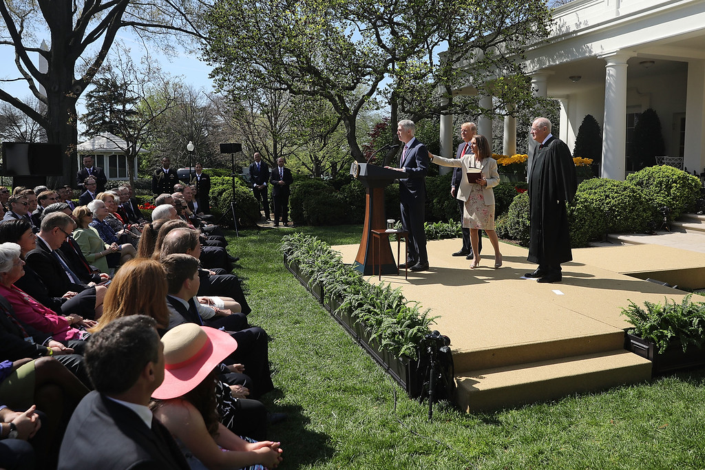 . WASHINGTON, DC - APRIL 10:  U.S. Supreme Court Associate Justice Neil Gorsuch\'s wife Marie Louise Gorsuch touches his back as he delivers remarks following the administration of the judicial oath by Associate Justice  Anthony Kennedy (R) as President Donald Trump looks on during a ceremony in the Rose Garden at the White House April 10, 2017 in Washington, DC. Earlier in the day Gorsuch, 49, was sworn in as the 113th Associate Justice in a private ceremony at the Supreme Court.  (Photo by Chip Somodevilla/Getty Images)