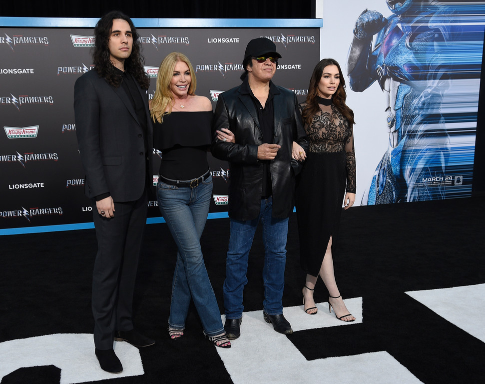 ". Nick Simmons, from left, Shannon Tweed, Gene Simmons and Sophie Simmons arrive at the Los Angeles premiere of Saban\'s ""Power Rangers\"" at the Regency Westwood Village Theatre on Wednesday, March 22, 2017. (Photo by Chris Pizzello/Invision/AP)"