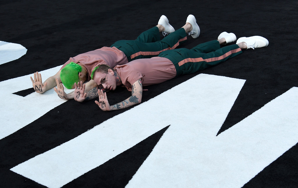 ". Mike Posner, left, and blackbear lie on the ground as they arrive at the Los Angeles premiere of Saban\'s ""Power Rangers\"" at the Regency Westwood Village Theatre on Wednesday, March 22, 2017. (Photo by Chris Pizzello/Invision/AP)"