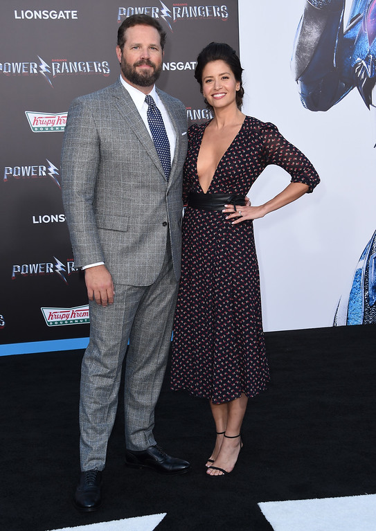 . Mercedes Mason and David Denman attend the red carpet arrivals for the world premiere of Power Rangers at the Village theatre in Hollywood, California on March 22, 2017. / AFP PHOTO / CHRIS DELMAS        (Photo credit should read CHRIS DELMAS/AFP/Getty Images)