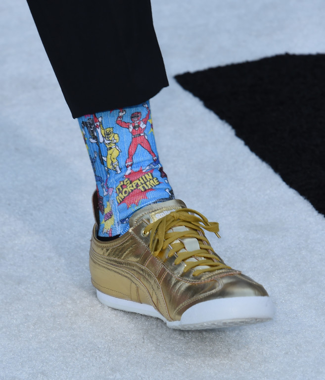 . Haim Saban (sock detail) attends the red carpet arrivals for the world premiere of Power Rangers at the Village theatre in Hollywood, California on March 22, 2017. / AFP PHOTO / CHRIS DELMAS        (Photo credit should read CHRIS DELMAS/AFP/Getty Images)