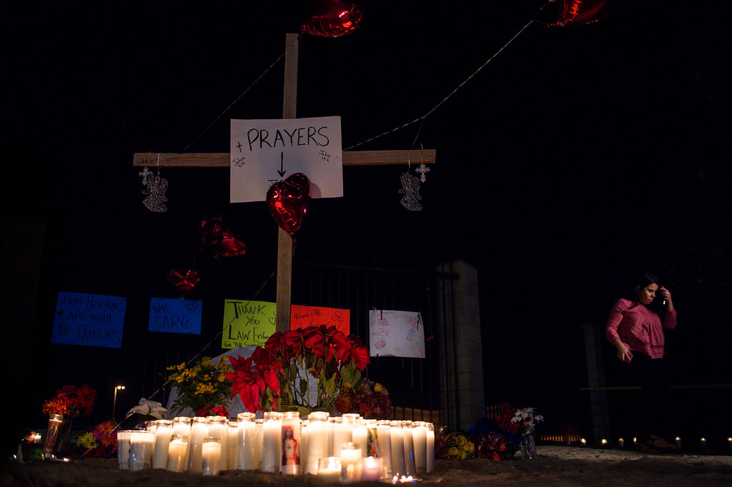 . Mourners gather at a makeshift memorial to remember those killed and injured in the Inland Regional Center shooting on Thursday night, December 3, 2015 in San Bernardino.  (Photo by Sarah Reingewirtz/Pasadena Star-News)