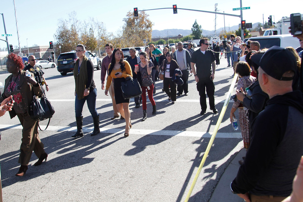 . Staff from the Inland Valley Regional Facility for the Mentally Disable walk to school buses  on Waterman Avenue after shooter, shot as many as 20 people at the Inland Valley Regional Facility in San Bernardino, CA., Wednesday, December 2, 2015. (Photo by James Carbone for the SAn Bernardino Sun)