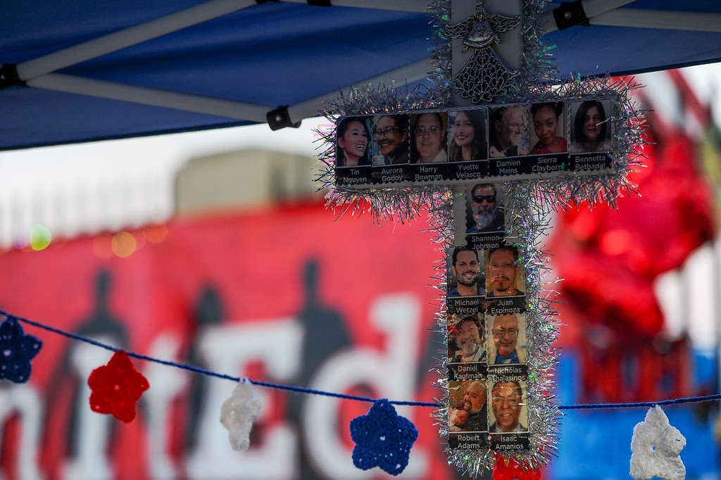 . The San Bernardino shooting memorial near the Inland Regional Center continues to expand on the sidewalk on the corner of Orange Show and Waterman Avenue in San Bernardino, CA on Monday, Dec. 14, 2015. (Photo by Rachel Luna/The Sun)