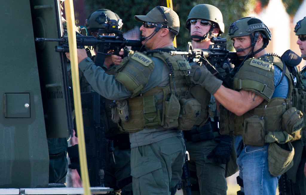 . Law enforcement officers search for a suspect involved where at least 14 people were killed and 14 others injured at an incident at the Inland Regional Center on Wednesday December 2, 2015.  (Photo by Keith Durflinger/Los Angeles News Group)