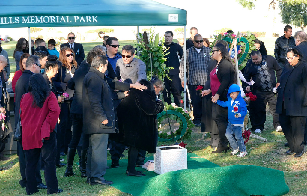 . Graveside services for San Bernardino shooting victim Aurora Godoy at the Green Hills Memorial Park in Rancho Palos Verdes.  Family and friends drop flowers into her grave. Photos by Brad Graverson/The Daily Breeze/LANG/12-16-15