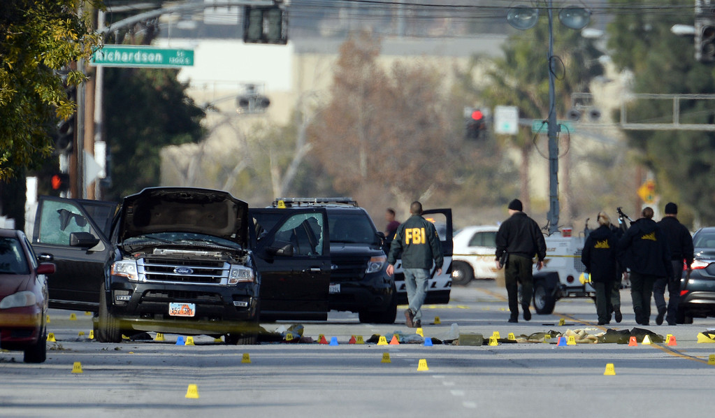 . Law enforcement officers investigate the scene on San Bernardino Avenue early Thursday, Dec. 3, 2015, following a police gun battle Wednesday which ended with the killing of the male and female suspects in the mass shooting which killed 14 people at the Inland Regional Center in San Bernardino. (Photo by Will Lester/Inland Valley Daily Bulletin)