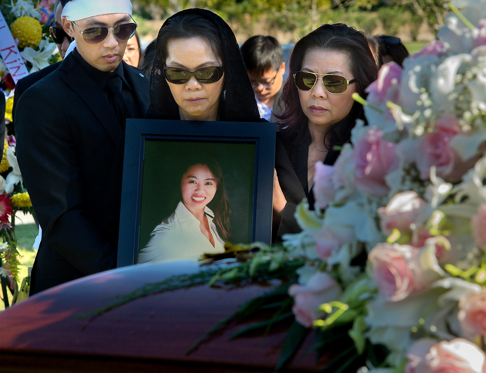 . Trung Do, with mother Van Nguyen adjacent to coffin of her daughter, Tin Nguyen, a 31-year-old food inspector for the San Bernardino County Department of Health, died Wednesday, December 2, 2015 in the mass shooting at Inland Regional Center in San Bernardino. Nguyen was engaged to Hansin Trinh. The couple was set to marry in 2016. Funeral services: are scheduled were held at Church of Saint Barbara in Santa Ana and burial was held at Good Shepherd Cemetery, Huntington Beach (Photo by Walt Mancini/Pasadena Star-News)