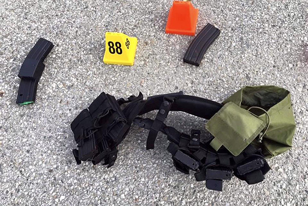 ". The San Bernardino County Sheriff\'s Department released crime scene photos Thursday December 3, 2015 from Wednesday\'s deadly shooting via social media, ""Photos from the scene of the officer involved shooting. Weapons & ammunition carried by the suspects.\"" (Courtesy photos)"