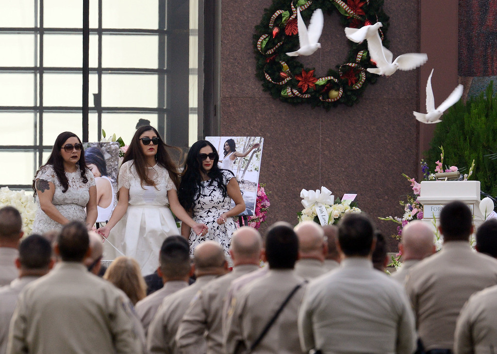 . The sisters of Yvette Velasco, Adriana, Genevieve and Erica Velasco, release doves Thursday December 10, 2015 during her funeral service at Forest Lawn in Covina. Velasco is the first of the 14 victims from the Dec. 2 Inland Regional Center mass shooting to be buried.  (Will Lester/Inland Valley Daily Bulletin)
