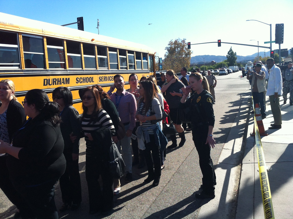 . Staff from the Inland Region Center are evacuated after authorities in San Bernardino responded to an active shooter near the Inland Regional Center. City fire officials say 15 to 20 people have been wounded. (Photo by James Carbone/for The Sun, Los Angeles News Group)