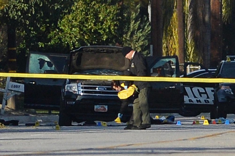 . Detectives work the scene near an SUV where, after a long gun battle, police shot and killed Syed Farook, 28, and Tashfeen Malik, 27, on Thursday, December 3, 2015, San Bernardino, Ca. Farook and Tashfeen were two suspects in the mass shooting that killed 14 people and wounded 17 others at Inland Regional Center on Wednesday morning.  (Micah Escamilla/The Sun)