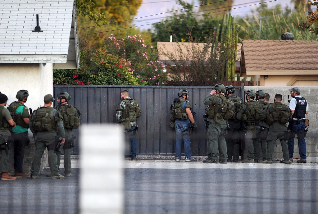 . Authorities search for suspects along Richardson Street after multiple shooters killed 14 people and injured 17 others at the Inland Regional Center on Wednesday, December 2, 2015, San Bernardino, Ca.  (Micah Escamilla/The Sun)