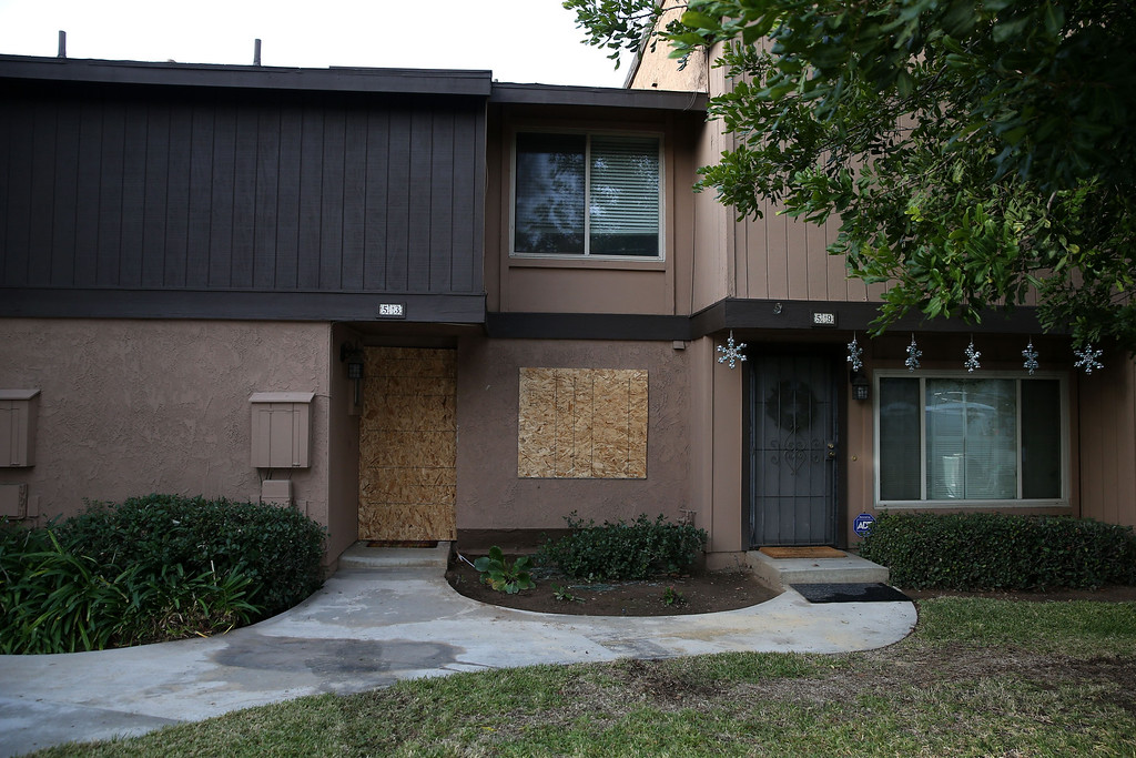 . REDLANDS, CA - DECEMBER 04:  Boards cover the windows of the home of Syed Farook after police and FBI investigators raided the home searching for evidence on December 4, 2015 in Redlands, California. The San Bernardino community is mourning as police continue to investigate a mass shooting at the Inland Regional Center in San Bernardino that left at least 14 people dead and another 21 injured.  (Photo by Justin Sullivan/Getty Images)