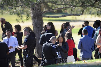 People gather at San Bernardino Golf Course after being evacuated from Inland Regional Center  where an active shooter situation has taken place on Wednesday, December 2, 2015, San Bernardino, Ca.  (Micah Escamilla/The Sun)