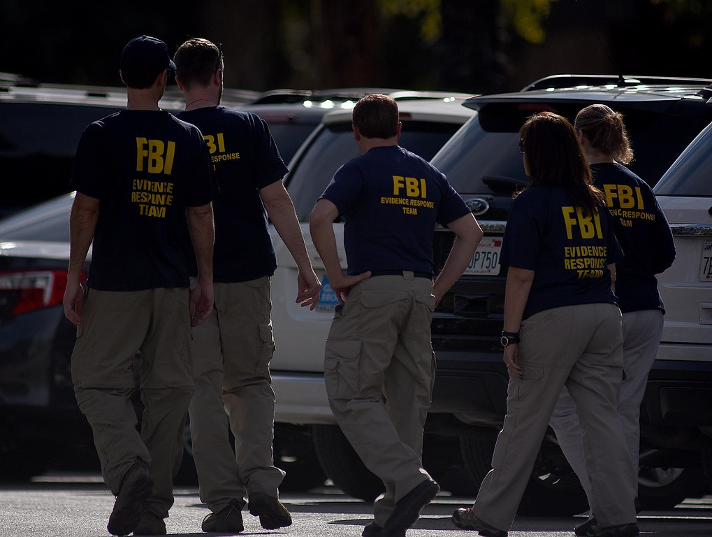 . The FBI and law enforcement officials are searching a Redlands home Thursday, December 3, 2015, in connection with Wednesday\'s deadly shooting in San Bernardino. Officials say the team has discovered thousands of rounds of ammunition and at least a dozen pipe bombs.  (Staff photo by Rick Sforza/Redlands Daily Facts)