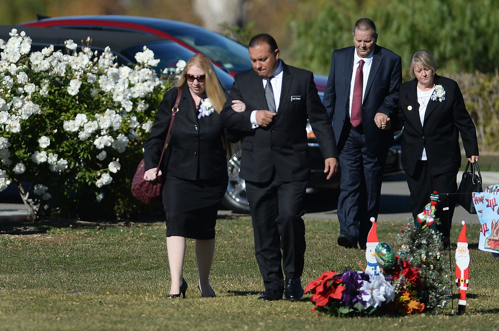 . Summer Adams, let, wife of Robert Adams who was one of 14 victims of the December 2 shootings at the Inland Regional Center, arrives at  Montecito Memorial Park for Robert\'s graveside ceremony in Colton, Ca. (Micah Escamilla/The Sun)