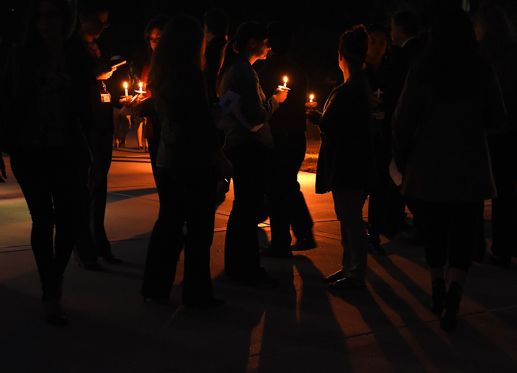 . A candlelight vigil for Damian Meins and the other 13 victims, of the Inland Regional Center mass shooting last week, at Riverside County Department in Riverside, CA., Tuesday, December 8, 2015. (Photo by Jennifer Cappuccio Maher/The Sun)