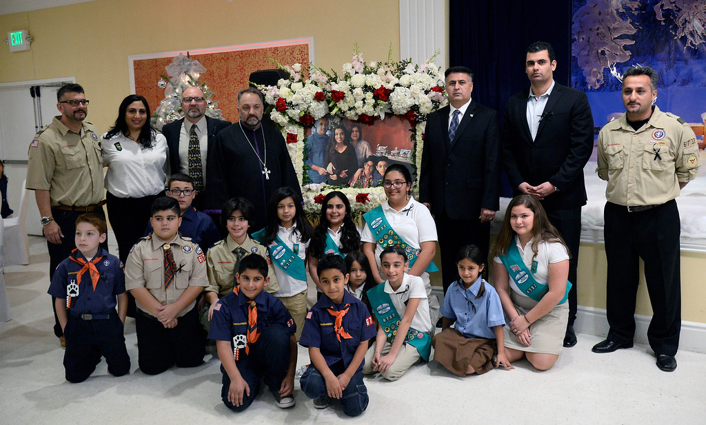 . Dec 3, 2015. North Hollywood CA.  Scout troop 6732 and other city officials pose together in honor of Benetta Betbadal\'s life during a prayer vigil and fundraiser. Betbadal was a mother of three children who was among the 14 who was shot by the terrorists in San Bernardino. She was also a scout leader for the local Assyrian Scout troop.  Photo by Gene Blevins/LA DailyNews