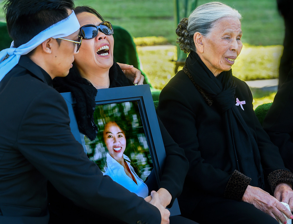 . Trung Do, son, comforts mother Van Nguyen, with grandmother Nghi Van Nguyen at burial services for Tin Nguyen, 31-year-old food inspector for the San Bernardino County Department of Health, died Wednesday, December 2, 2015 in the mass shooting at Inland Regional Center in San Bernardino. Nguyen was engaged to Hansin Trinh. The couple was set to marry in 2016. Funeral services: are scheduled were held at Church of Saint Barbara in Santa Ana and burial was held at Good Shepherd Cemetery, Huntington Beach (Photo by Walt Mancini/Pasadena Star-News)