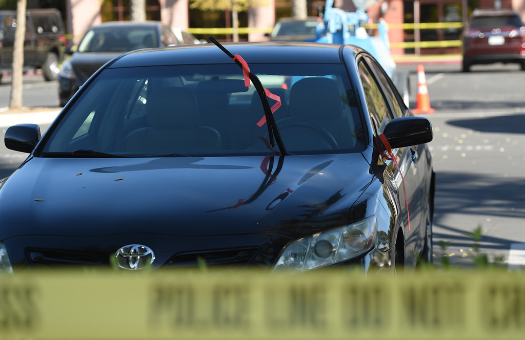 . A orange ribbon tied to a windshield wiper of a car with the name Amqnios, waves in the wind. Isaac Amanios was one of the victims from last weeks San Bernardino Shooting at the Inland Regional Center that left 14 dead last week, Monday, December 7, 2015. (Photo by John Valenzuela/The Sun)