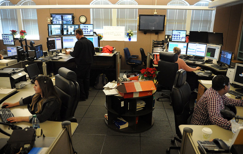 . From left, Missy Havins, Joe Goff, Annie Teall, and Andre Brown, some of the dispatchers who handled calls during last week\'s mass shooting at Inland Regional Center, answer calls on Wednesday, December 9, 2015 at the San Bernardino Police Department in San Bernardino, Ca. (Micah Escamilla/The Sun)