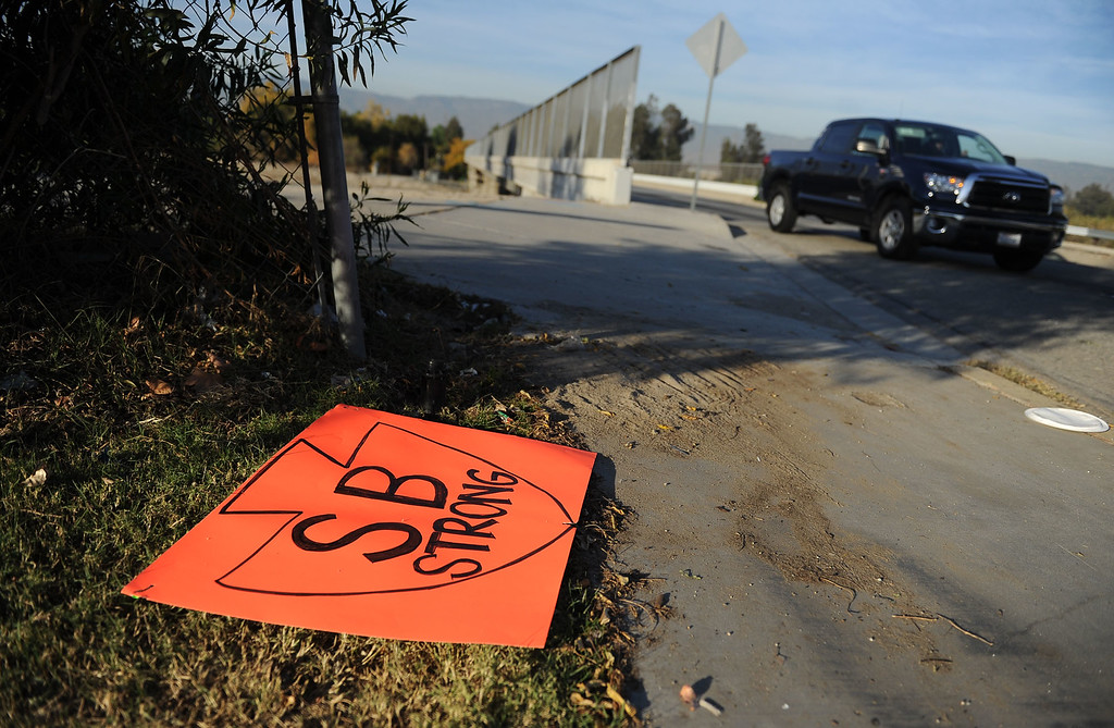 ". An ""SB Strong\"" sign is seen on the ground along Waterman Avenue near the scene of last week\'s mass shooting seen on Wednesday, December 9, 2015 in San Bernardino, Ca. (Micah Escamilla/The Sun)"