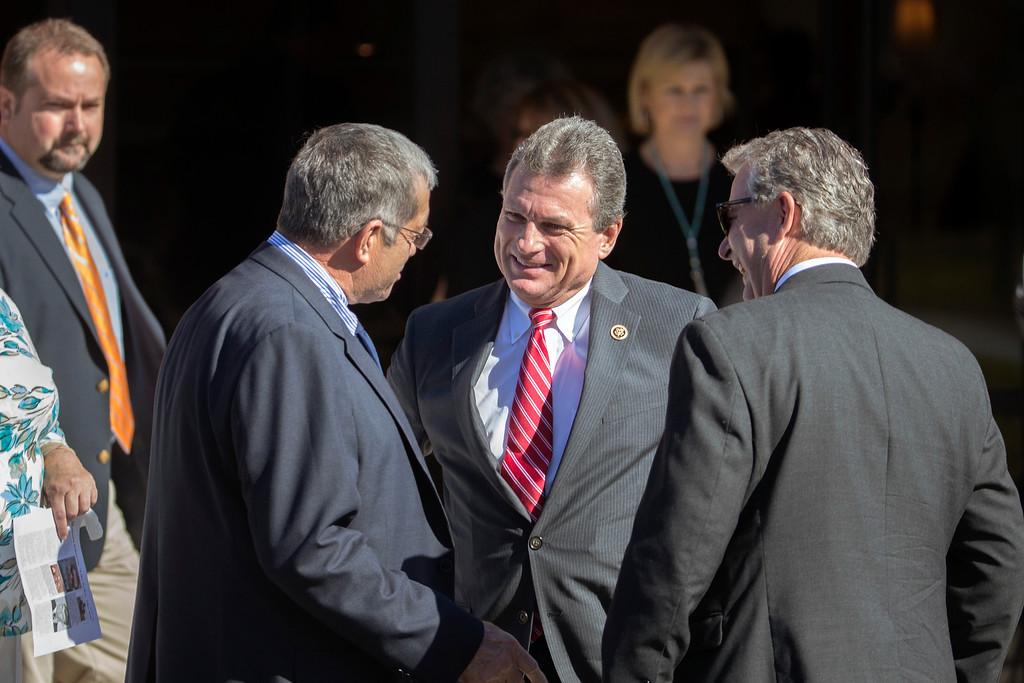. U.S. Representative Buddy Carter, center,(R-GA) greets people after the service for Shannon Johnson at the Calvary Baptist Church in Jesup, Ga., Saturday, Dec. 12, 2015. Shannon Johnson died in the mass shooting in San Bernardino, Calif., on Dec. 2. (AP Photo/Stephen B. Morton)