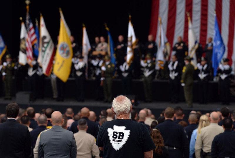 . A man wearing an SB Strong shirt watches from the audience as first responders are honored for their bravery during the December 2 terrorist attack at the Inland Regional Center in San Bernardino during an awards ceremony held on Thursday, April 14, 2016 in at San Manuel Amphitheater in San Bernardino, Ca. (Micah Escamilla/The Sun)