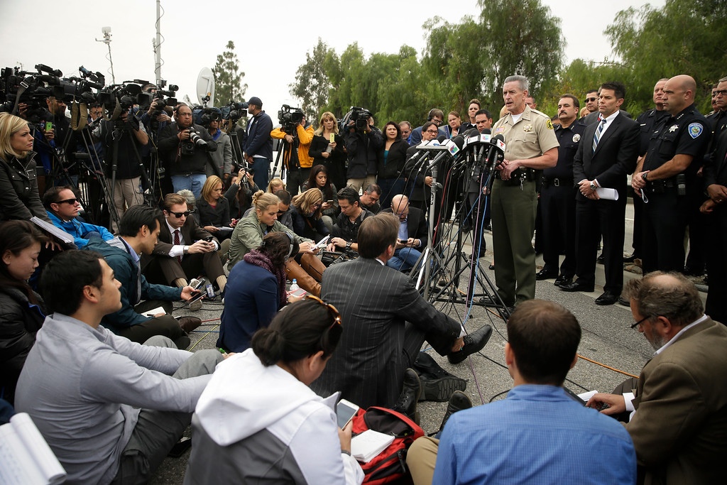 . San Bernardino County Sheriff John McMahon talks to reporters during a news conference Friday, Dec. 4, 2015, in San Bernardino, Calif.  The FBI said Friday it is officially investigating the mass shooting in California as an act of terrorism, while a U.S. law enforcement official said the woman who carried out the attack with her husband had pledged allegiance to the Islamic State group and its leader on Facebook. (AP Photo/Jae C. Hong)