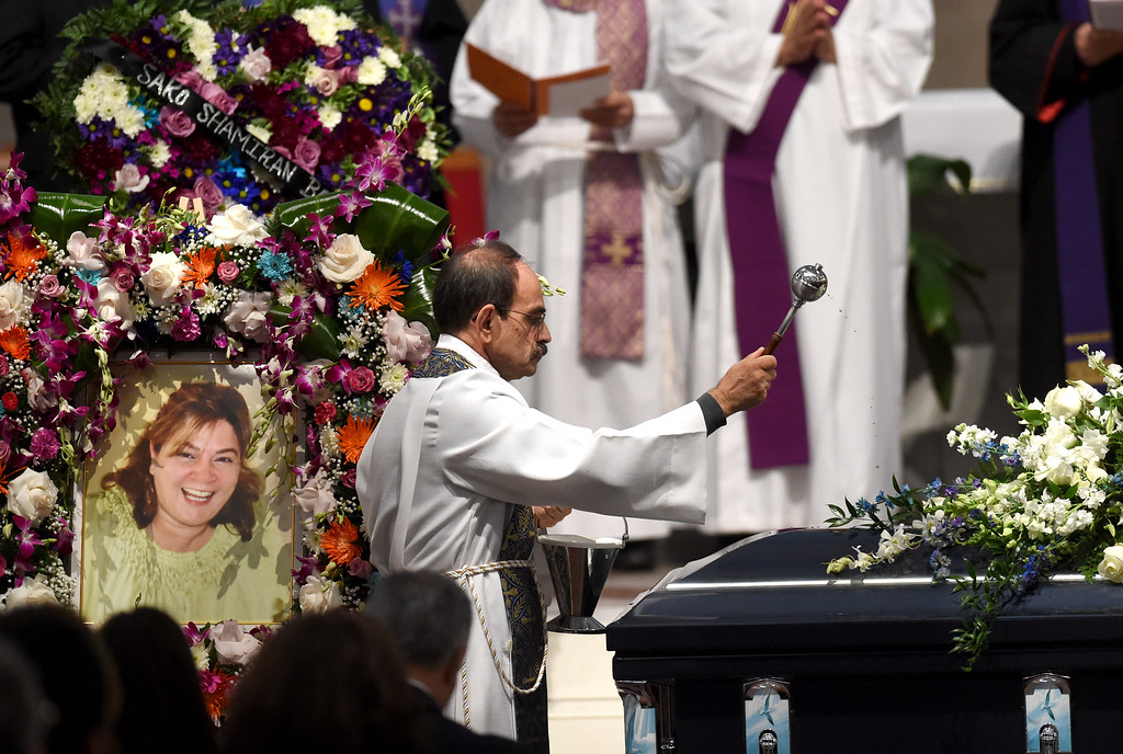 . The coffin of San Bernardino shooting victim Bennetta Bet-Badal, is blessed during her funeral service at Sacred Heart Catholic Church Rancho Cucamonga, Ca. Monday, December 14, 2015. Bet-Badal was one of fourteen killed in the December 2, mass shooting at the Inland Regional Center in San Bernardino. (Photo by John Valenzuela/The Sun)