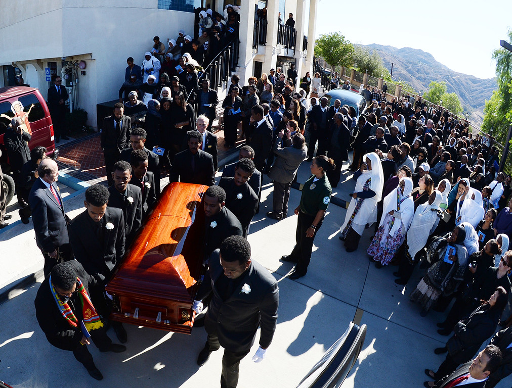 . The casket containing Issac Amanios, 60, is brought out to a waiting hearse outside of St. Minas Orthodox Church in Colton December 12, 2015 following his funeral service. Amanios was one of the 14 victims from the Dec. 2 Inland Regional Center mass shooting.  (Will Lester/Inland Valley Daily Bulletin)