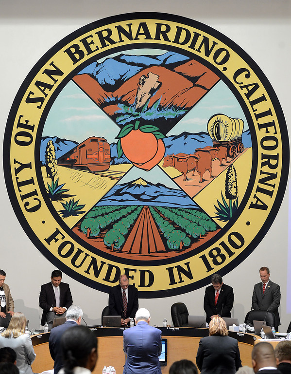 . Members of the San Bernardino City Council hold a moment of silence for the victims of the mass shooting as they hold their first open meeting, since the mass shooting at the Inland Regional Center last week, at City Hall San Bernardino, CA., Monday, December 7, 2015. (Photo by Jennifer Cappuccio Maher/The Sun)