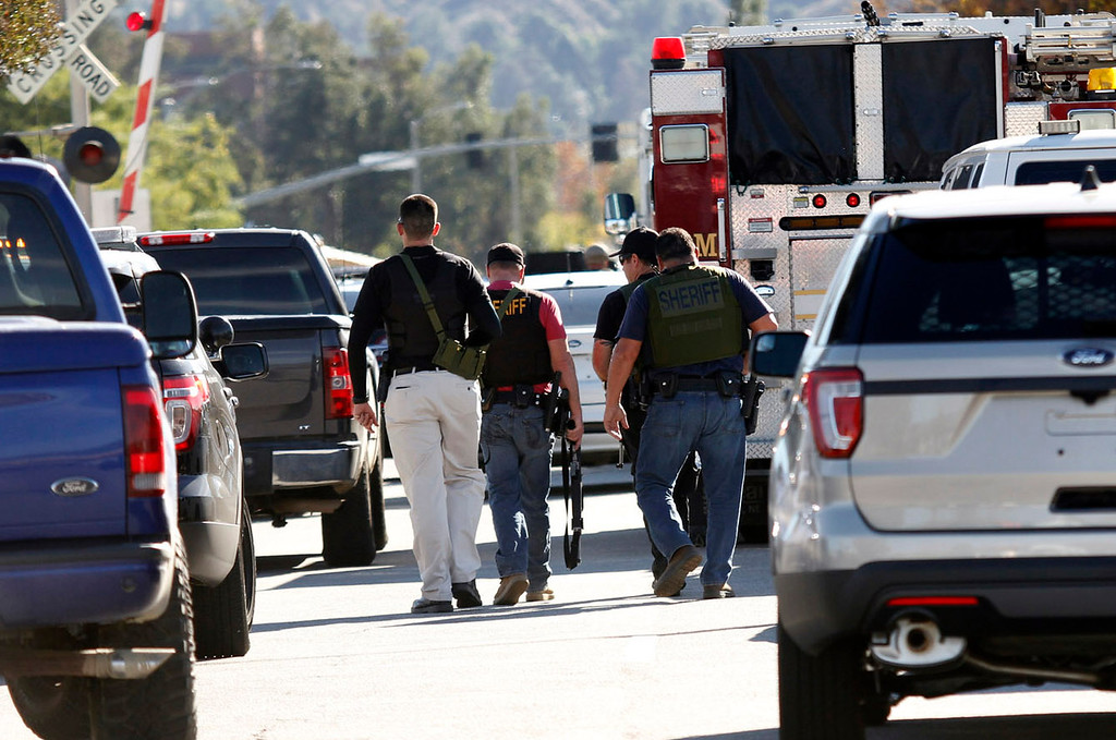 . Los Angeles County Sheriff walk to the Inland Valley Regional Facility for the Mentally Disable, after shooter shot as many as 20 people at the Inland Valley Regional Facility in San Bernardino, CA., Wednesday, December 2, 2015. (Photo by James Carbone for the SAn Bernardino Sun)