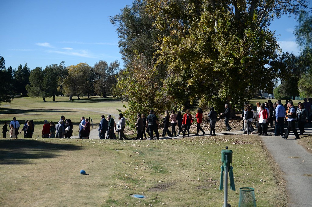 . People gather at San Bernardino Golf Course after being evacuated from Inland Regional Center  where an active shooter situation has taken place on Wednesday, December 2, 2015, San Bernardino, Ca.  (Micah Escamilla/The Sun)