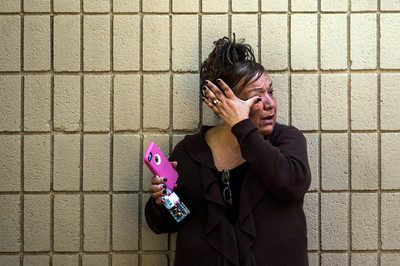 . A woman waits to reunite with her sister at the Rudy C Hernandez Community Center in San Bernardino following a shooting that has left 14 dead and 17 wounded. (Staff photo by Wathara Phomicinda/The Sun)