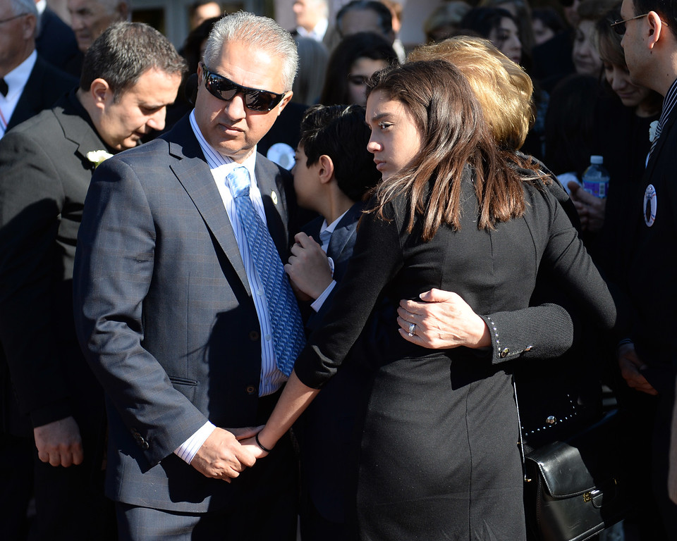 . Arlen Verdehyou, husband of Bennetta Bet-Babal, and daughter Jolene Verdehyou console with family members during the conclusion funeral service for San Bernardino shooting victim at Sacred Heart Catholic Church Rancho Cucamonga, Ca. Monday, December 14, 2015. Bet-Badal was one of fourteen killed in the December 2, mass shooting at the Inland Regional Center in San Bernardino. (Photo by John Valenzuela/The Sun)
