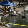 Members of the FBI Underwater Search and Evidence Response Team and bomb techs work Seccombe Lake on Thursday, December 10, 2015 in San Bernardino, Ca. (Micah Escamilla/The Sun)