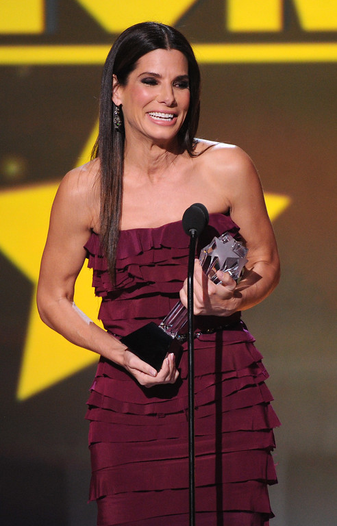 ". Sandra Bullock accepts the award for best actress in an action movie for ""Gravity\"" at the 19th annual Critics\' Choice Movie Awards at the Barker Hangar on Thursday, Jan. 16, 2014, in Santa Monica, Calif. (Photo by Frank Micelotta/Invision/AP)"