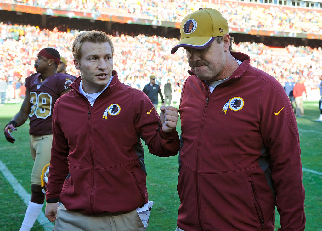 . Washington Redskins offensive coordinator Sean McVay, walks off the field with head coach Jay Gruden after an NFL football game against the Tennessee Titans, Sunday, Oct. 19, 2014, in Landover, Md. The Redskins won 19-17. (AP Photo/Richard Lipski)