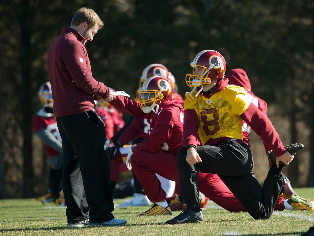 . Washington Redskins offensive coordinator Sean McVay, left, talks to quarterback Kirk Cousins (8), during an NFL football team practice at Redskins Park in Ashburn, Va., Wednesday, Jan. 6, 2016.  (AP Photo/Manuel Balce Ceneta)