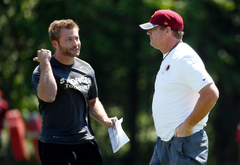. Washington Redskins offensive coordinator Sean McVay, left, talks with head coach Jay Gruden during practice at the team\'s NFL football training facility at Redskins Park, Wednesday, June 8, 2016 in Ashburn, Va. (AP Photo/Alex Brandon)
